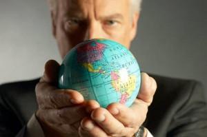 Businessman holding globe uid 1280294